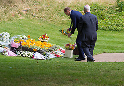 Hyde Park, London, July 7th 2015. Families of the victims and survivors of the 7/7 bombings in London gather at Hyde Park and are joined by the Duke of Cambridge Prince William at an emotional service commemorqating the Islamist terrorist bombing outrage that happened on London's transport network, claiming 57 lives and left scores of people injured. PICTURED: HRH the Duke of Cambridge Prince William lays flowers at the memorial.