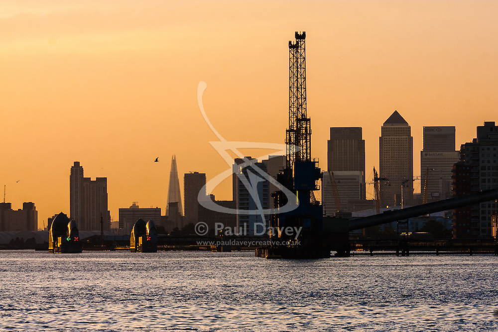 North Woolwich, London, October 28th 2014. London's skyline, seen from North Woolwich, is silhouetted against the setting sun.
