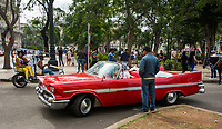 Havana, Cuba - A taxi stops in front of Hotel Parque Central (Central Park). Classic American cars from the 1950s, imported before the U.S. embargo, are commonly used as taxis in Havana.