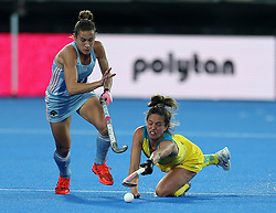 Argentina's Martina Cavallero and Australia's Brooke Peris in action