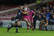 Gloucester centre Henry Trinder (13) caught in a tackle during the European Rugby Challenge Cup match between Gloucester Rugby and SU Agen at the Kingsholm Stadium, Gloucester, United Kingdom on 19 October 2017. Photo by Gary Learmonth.