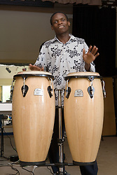 Member of the Hohodza band (www,hohodzaband,co,uk) drumming on stage during a community Diversity day event; Nottingham,