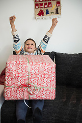 Cheerful boy with Christmas present