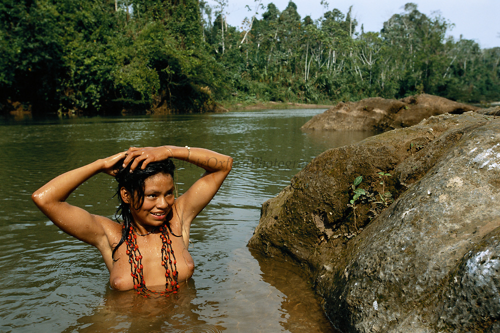 Machiguenga Indian Bathing<br />Timpia Community<br />Lower Urubamba River. Amazon Rain Forest<br />PERU.  South America