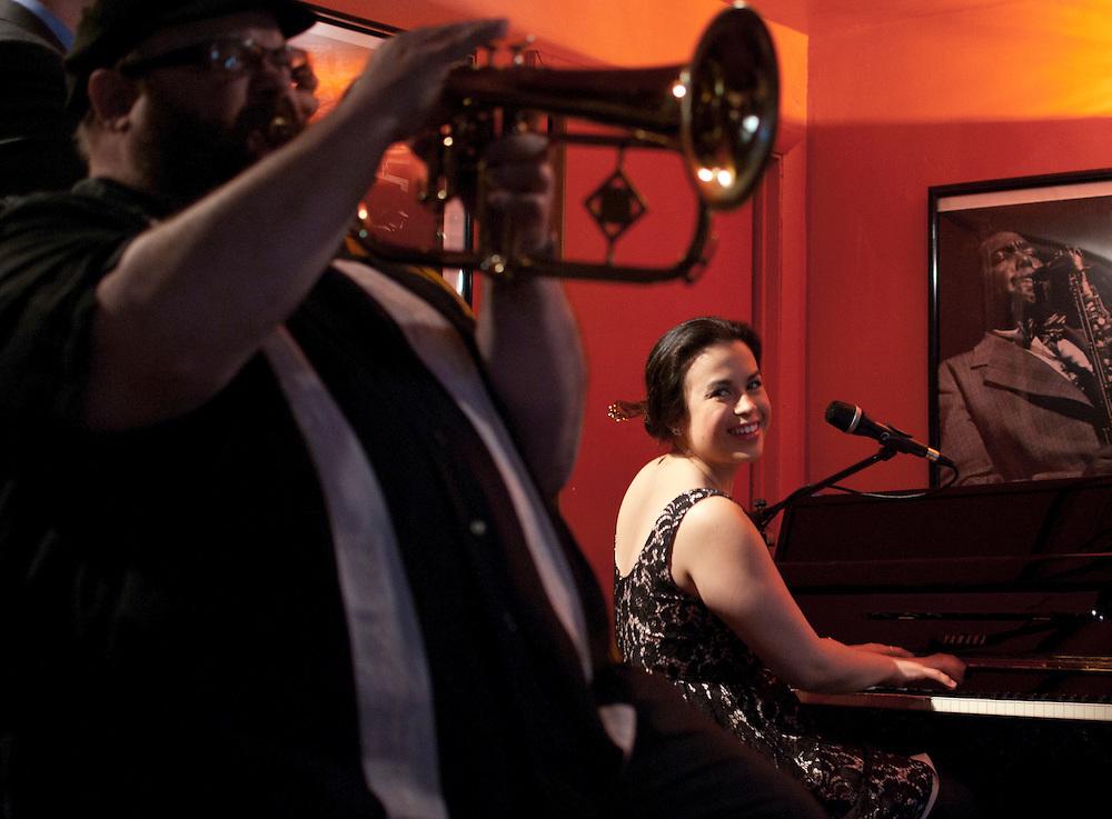 Jazz pianist Champian Fulton looks over her shoulder at father Stephen Fulton on flugelhorn. At Nine48Jazz in Nashville, TN.