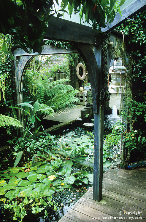 Pond area with tree fern and mirror.