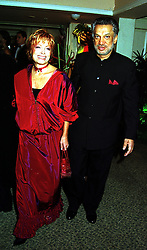 MR GULU LALVANI, a friend of the late Diana, Princess of Wales and his wife MRS SEMIRAMIS LALVANI, at a ball in London on 7th November 1999.MYP 52