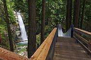 Cascade Falls and the suspension bridge in Cascade Falls Regional Park near Mission, British Columbia, Canada