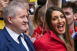 London, UK. 23rd March, 2019. Ian Blackford MP, Leader of the Scottish National Party (SNP) in Westminster, and Dr Rosena Allin-Khan, Labour MP for Tooting, take part in a People's Vote march through central London before attending a rally in Parliament Square.