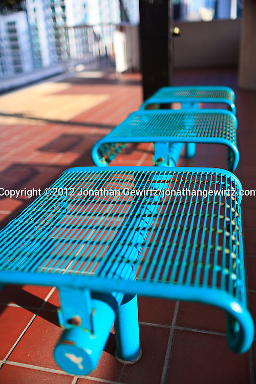Blue metal benches in a downtown Miami Metromover elevated rail station. WATERMARKS WILL NOT APPEAR ON PRINTS OR LICENSED IMAGES.