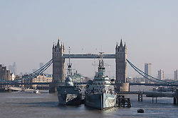 © Licensed to London News Pictures. 13/02/2017. LONDON, UK.  The German Navy spy ship, FGS Oker A53 moored next to HMS Belfast in front of Tower Bridge on the River Thames during a London visit, shortly before leaving this afternoon. FGS Oker A53 is one of the Oste class ships, that are purpose built intelligence collection spy ships and were primarily designed to gather data on Soviet warships.  Photo credit: Vickie Flores/LNP.