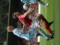Photo: Ian Hebden.<br />Nottingham Forest v Chesterfield. Coca Cola League 1. 02/09/2006.<br />Forest's Neil Harris (R) shields the ball from Chesterfields Derek Niven (L).