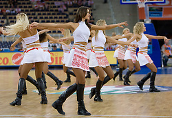 """Cheerleading group Red Foxes of Ukraine dance on Slovenian song """"Na Roblek"""" of Avseniki during the EuroBasket 2009 Group F match between Slovenia and Lithuania, on September 12, 2009 in Arena Lodz, Hala Sportowa, Lodz, Poland.  (Photo by Vid Ponikvar / Sportida)"""