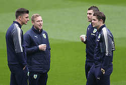 Burnley's players inspecting the pitch before the game against Leicester City
