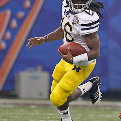 January 3, 2012; New Orleans, LA, USA; Michigan Wolverines quarterback Denard Robinson (16) against the Virginia Tech Hokies during the Sugar Bowl at the Mercedes-Benz Superdome. Michigan defeated Virginia 23-20 in overtime. Mandatory Credit: Derick E. Hingle-US PRESSWIRE