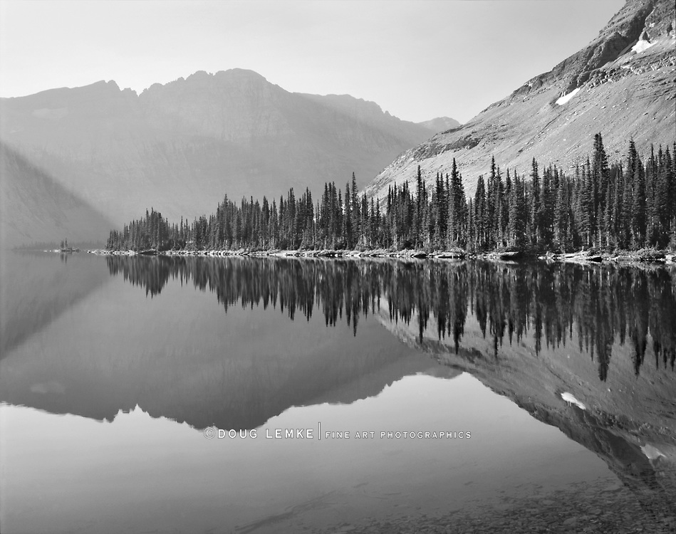 A perfect reflection in a mountain lake during early morning at Glacier National Park, Montana, USA