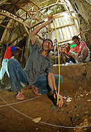 The positions of stone hobbit tools unearthed at Liang Bua cave are carefully measured and recorded by experienced Manggarai workers.