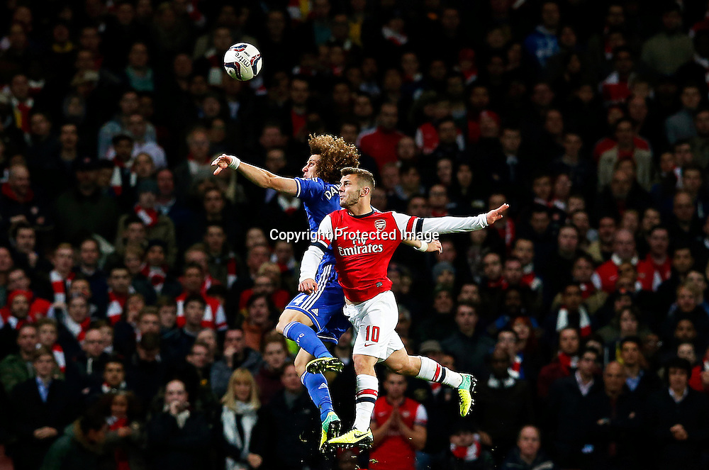 epa03939213 YEARENDER 2013 OCTOBER<br /> Jack Wilshere (R) of Arsenal in action against David Luiz (L) of Chelsea during the English League Cup round of 16 soccer match between Arsenal FC and Chelsea FC in London, Britain, 29 October 2013. Chelsea won 2-0.  EPA/KERIM OKTEN DataCo terms and conditions apply. https://www.epa.eu/downloads/DataCo-TCs.pdf