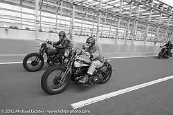 """""""Sushi"""" Atsushi Yasui beside the Race of Gentlemen's Mel Stultz on a ride around Tokyo with friends of the Freewheelers And Company shop. Tokyo, Japan. December 8, 2015.  Photography ©2015 Michael Lichter."""