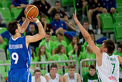 Leo Westermann of France shots while Edgaras Ulanovas of Lithuania tries to block the shot during basketball match between National teams of Lithuania and France in Final match of U20 Men European Championship Slovenia 2012, on July 22, 2012 in SRC Stozice, Ljubljana, Slovenia. Lithuania defeated France 50:49 and become European champions. (Photo by Matic Klansek Velej / Sportida.com)