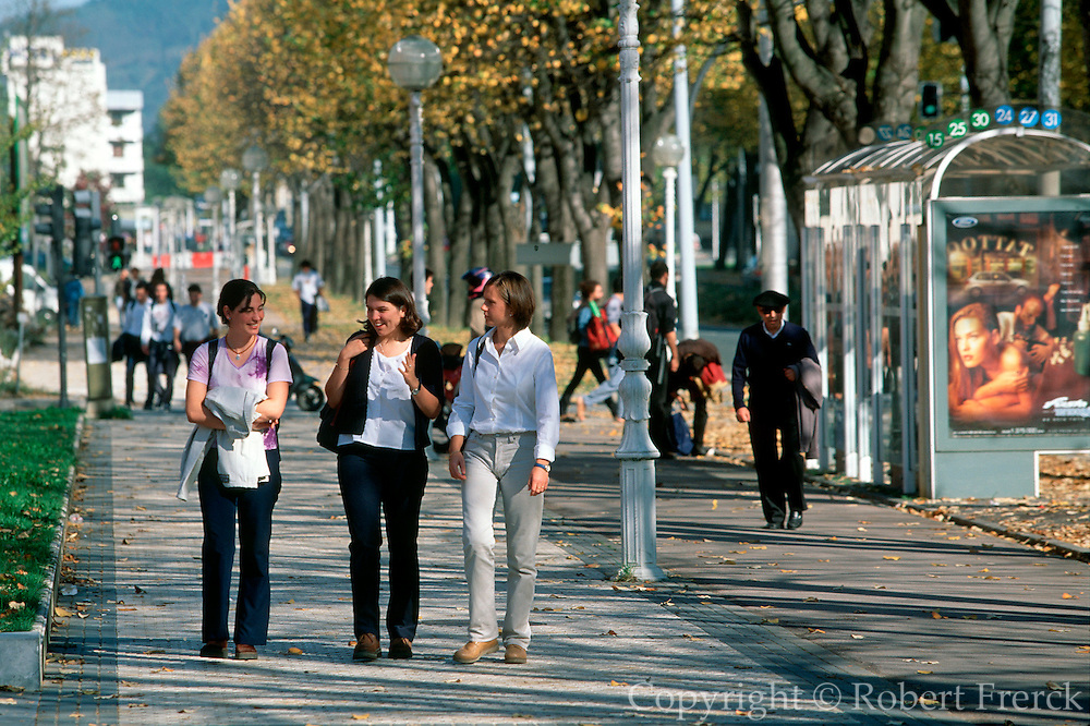 SPAIN, BASQUE REGION, EDUCATION SAN SEBASTIAN; students at bus stop on the  campus of the regional University on the outskirts of the city