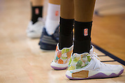 Players wear their WNBA socks with logos taped out on their sneakers during a WNBA preseason game between the Dallas Wings and the Connecticut Sun in Arlington, Texas on May 8, 2016.  (Cooper Neill for The New York Times)