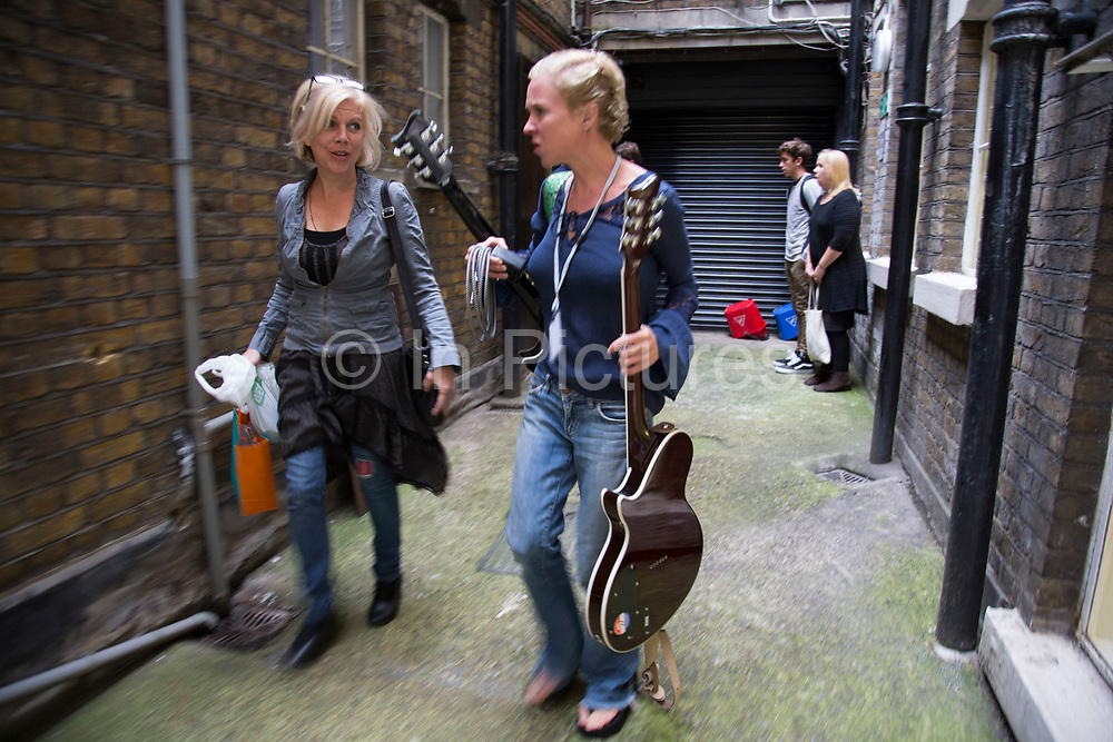 Singers Tanya Donelly and Kristin Hersh walking to the backstage area. Throwing Muses at the Islington Assembly Hall, London, UK. Throwing Muses are an alternative rock band founded in 1980. The group was originally fronted by two lead singers, Kristin Hersh, and Tanya Donelly. Known for performing music with shifting tempos, creative chord progressions, unorthodox song structures, and surreal lyrics, the group was set apart from other contemporary acts by Hersh's stark, writing style, David Narcizo's unusual drumming techniques almost totally without cymbals and Bernard Georges' driving baselines.