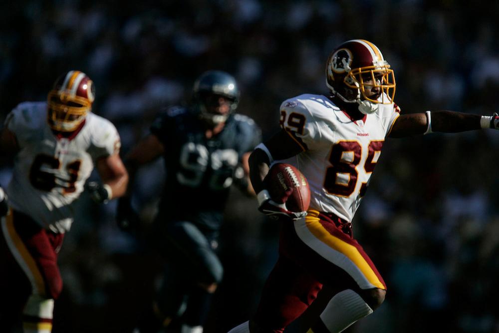 Jay Westcott/Examiner   SP   Oct. 2, 2005 -  Washington Redskins vs. Seattle Seahawks - #89 Santana Moss runs after catching a pass from Brunell that set up the game winning field goal.