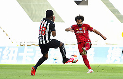 LIVERPOOL, ENGLAND - Sunday, July 26, 2020: Liverpool's Mohamed Salah shoots during the final match of the FA Premier League season between Newcastle United FC and Liverpool FC at St. James' Park. The game was played behind closed doors due to the UK government's social distancing laws during the Coronavirus COVID-19 Pandemic. Liverpool won 3-1 and finished the season as Champions on 99 points. (Pic by Propaganda)