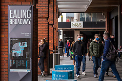 © Licensed to London News Pictures. 17/10/2020. LONDON, UK. Shoppers wearing facemasks enter a shopping centre in Ealing, west London.  The Office for National Statistics (ONS) has reported that the confirmed coronavirus cases in the capital exceed 67,000, with Ealing having the highest Covid-19 rate amongst London Boroughs at 144 cases per 100.  Following the UK Government's announcement, the capital has today moved from Tier 1 to Tier 2, meaning a ban on indoor social mixing between households in the capital.  Photo credit: Stephen Chung/LNP