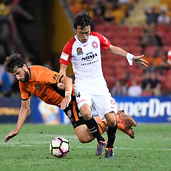 BRISBANE, AUSTRALIA - DECEMBER 22: Jumpei Kusukami of the Wanderers is tackled by Thomas Broich of the Roar during the round 4 Foxtel National Youth League match between the Brisbane Roar and Melbourne City at AJ Kelly Field on December 22, 2016 in Brisbane, Australia. (Photo by Patrick Kearney/Brisbane Roar)