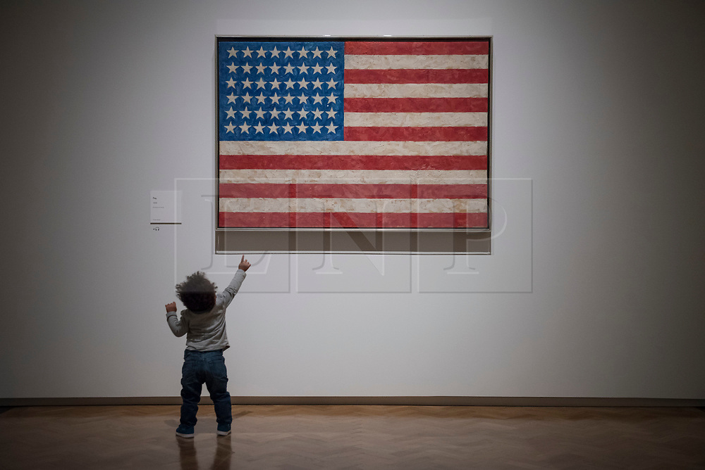 """© Licensed to London News Pictures. 19/09/2017. London, UK. A young visitor views """"Flag"""", 1958, by Jasper Johns.  Preview of a landmark exhibition by Jasper Johns RA called """"Something Resembling Truth"""" at the Royal Academy of Arts in Piccadilly.  Sculptures, drawing, prints plus new works are on display 25 September to 10 December 2017.   Photo credit : Stephen Chung/LNP"""