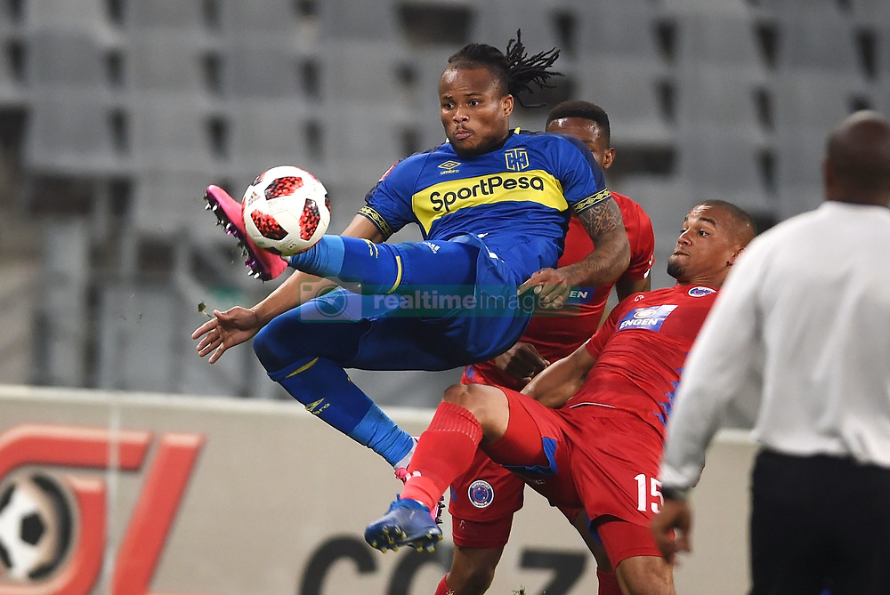 Cape Town-180804 Cape Town City defender Edmilson Dove challenged by Fagrie Lakay of Supersport as he clears an aerial ball from the goalpost  in the first game of the 2018/2019 season at Cape Town Stadium.photograph:Phando Jikelo/African News Agency/ANAr