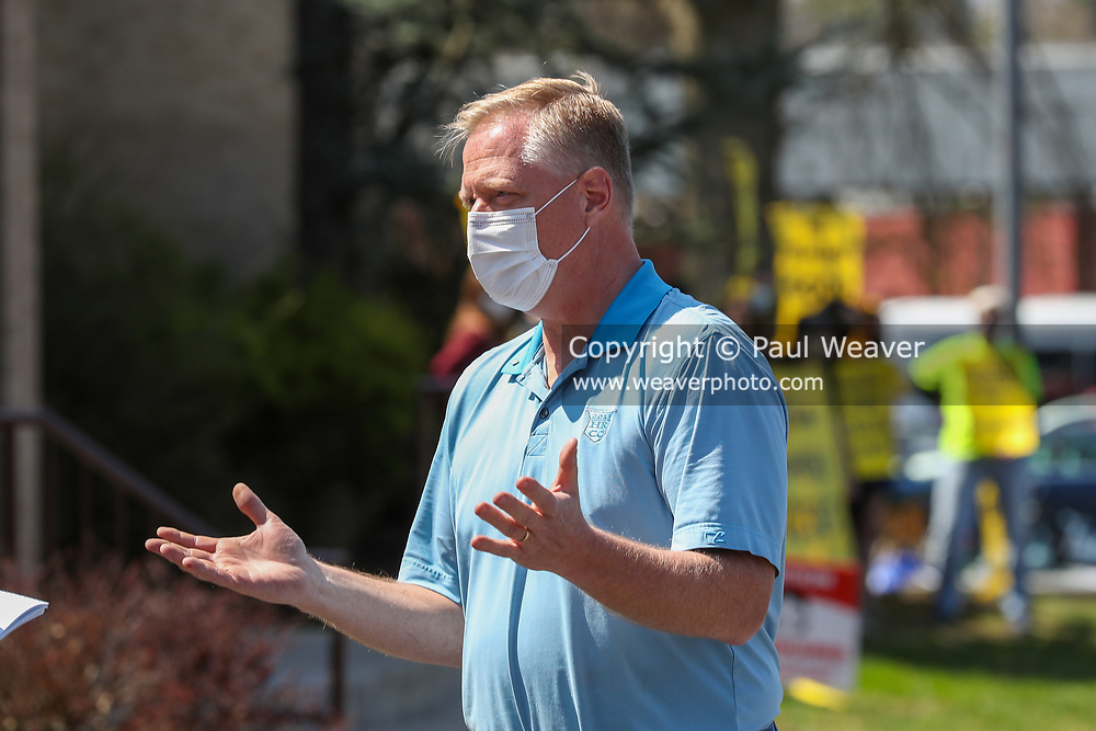 Congressman Fred Keller (R-PA) speaks to a reporter as constituents hold a rally outside of his district office in Selinsgrove, Pennsylvania on April 7, 2021. Sunrise Movement groups from Lewisburg and State College rallied outside of Keller's office to demand that he sign the Good Jobs for All Congressional Pledge.