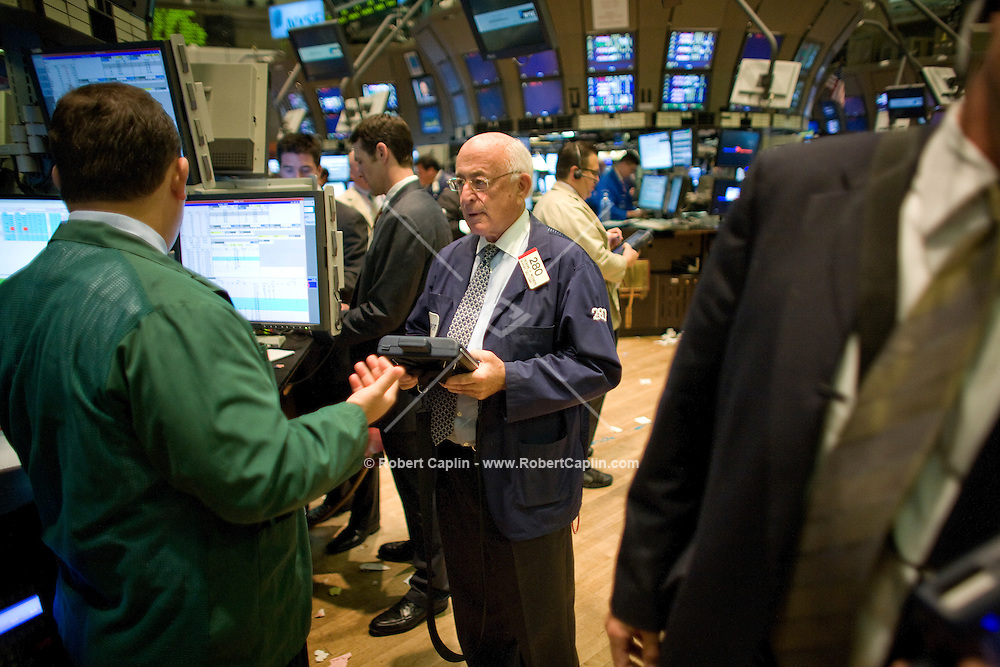 """Trader Ted Weisberg works on the floor of the New York Stock Exchange on the 20 year anniversary of the """"Black Monday"""" market crash of 1987, Monday, Oct. 15, 2007. Photographer: Robert Caplin For LA TImes"""