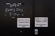 MERTHYR TYDFIL, WALES - 11 MAY 2020 - Signs on a local pub stating that they are closed due to the corona virus epidemic in Wales.