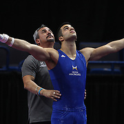 Danell Leyva, Homestead, Florida, with his coach his stepfather, Yin Alvarez in action on the Still Rings during the Senior Men Competition at The 2013 P&G Gymnastics Championships, USA Gymnastics' National Championships at the XL, Centre, Hartford, Connecticut, USA. 16th August 2013. Photo Tim Clayton