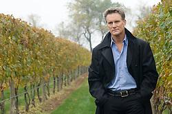 Good looking mature man walking in a vineyard