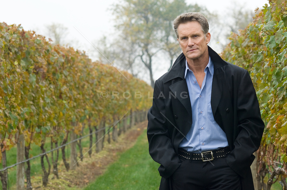 Good looking mature man walking in a vineyard