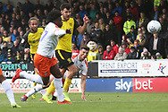 Burton Albion midfielder Marcus Harness (16) shoots at goal but his shot is taped onto the crossbar by Luton Town goalkeeper James Shea (36) during the EFL Sky Bet League 1 match between Burton Albion and Luton Town at the Pirelli Stadium, Burton upon Trent, England on 27 April 2019.