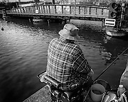 GHENT, BELGIUM - 02/04/2007 - DAILY LIFE / LEUSURE - De Muide, A fisherman at his favorite spot along the wiedauwkaaispoorwegbrug. The fish is absolutly not eatable due to heavy metals and bad taste.<br /> <br /> fish, fishing, bridge, water, pollution, railway, railroad, waterway, ghent-terneuzen, canal<br /> <br /> <br /> REPORTERS©Christophe Vander Eecken