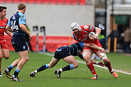 Jake Ball of the Scarlets ® is stopped by Lloyd Williams of the Scarlets.  Guinness Pro12 rugby match, Scarlets  v Cardiff Blues at the Parc y Scarlets in Llanelli, West Wales on Saturday 2nd April 2016.<br /> pic by  Andrew Orchard, Andrew Orchard sports photography.