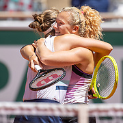 PARIS, FRANCE June 13.  Barbora Krejcikova and Katerina Siniakova of the Czech Republic celebrate their victory against Bethanie Mattek-Sands of the United States and Iga Swiatek of Poland  on Court Philippe-Chatrier during the final of the doubles competition at the 2021 French Open Tennis Tournament at Roland Garros on June 13th 2021 in Paris, France. (Photo by Tim Clayton/Corbis via Getty Images)
