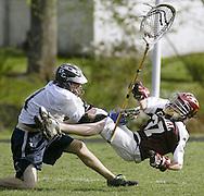 Dane Wakefield, left, of John S. Burke Catholic hits James I. O'Neill goalie Ed Mrozik during a game in Goshen on Friday, May 1, 2009. ththr LACROSSE HIT