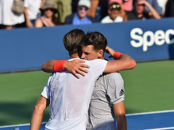 August 29, 2018 - Flushing Meadow, NY, U.S. - FLUSHING MEADOW, NY - AUGUST 29:  Dominic Thiem (AUT) and Steve Johnson (USA) embrace at the net after Thiem defeated Johnson during the second round of the Men's Singles Championships at the US Open on August 29, 2018, played at the Billie Jean King Tennis Center, Flushing Meadow, NY.  (Photo by Cynthia Lum/Icon Sportswire) (Credit Image: © Cynthia Lum/Icon SMI via ZUMA Press)