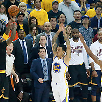12 June 2017: Cleveland Cavaliers guard JR Smith (5) takes a jump shot over Golden State Warriors forward Matt Barnes (22) and Golden State Warriors forward Andre Iguodala (9) during the Golden State Warriors 129-120 victory over the Cleveland Cavaliers, in game 5 of the 2017 NBA Finals, at the Oracle Arena, Oakland, California, USA.