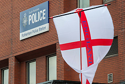 """Rotherham England<br /> 13 September 2014 <br /> EDL supporters hold a rally outside Main Street Police station as part of the English Defence Leagues """"Justice for the Rotherham 1400"""" March described by an EDL Facebook Page as """"a protest against the Pakistani Muslim grooming gangs"""" on Saturday Afternoon <br /> <br /> <br /> Image © Paul David Drabble <br /> www.pauldaviddrabble.co.uk"""