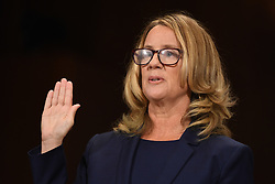 September 27, 2018 - Washington, District of Columbia, U.S. - CHRISTINE BLASEY FORD, the woman accusing Supreme Court nominee Judge Kavanaugh of sexually assaulting her at a party 36 years ago, testifies before the US Senate Judiciary Committee on Capitol Hill.  (Credit Image: © Saul Loeb/CNP via ZUMA Wire)