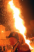 A large pole covered by heather and juniper is burning in good auspices in the town of Ivrea, pop. 30.000. During the days of the Carnival, Ivrea becomes crammed with tourists coming to witness the event which finds its roots at the end of the XII Century, when the people led an insurrection against the local tyrant, Count Ranieri of Biandrate, who was exercising the 'jus primae noctis' rule (having the first night) on the local young brides. The battle to overthrow him is represented with a 3-day-fight between factions in which more then 400 tonnes of oranges are thrown. During the celebrations, food stalls, bands playing music, and parades are also present, giving it a typical Medieval atmosphere. .