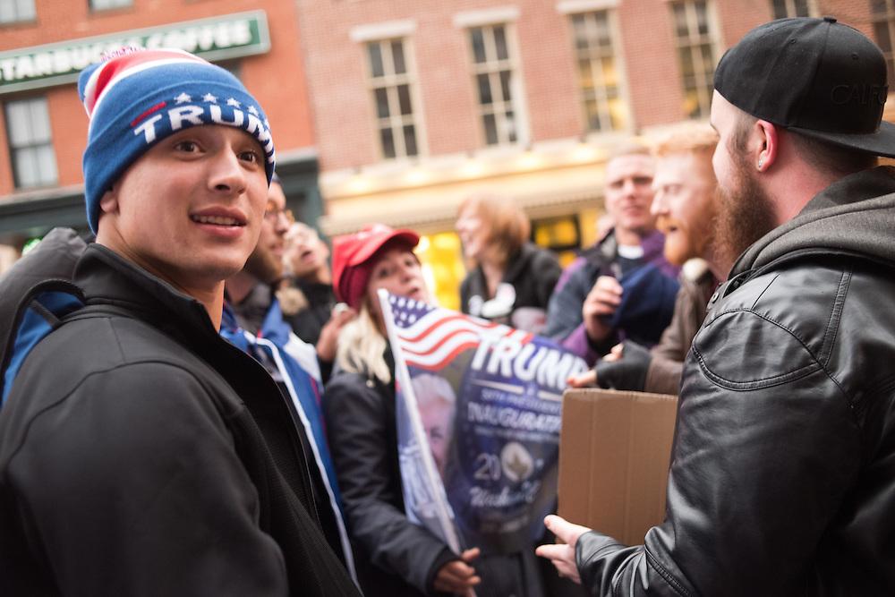 Protestor and Trump supporter debating/ arguing. Inauguration of Donald Trump and demonstrators and various entrances,  Washington DC. 20  January 2017